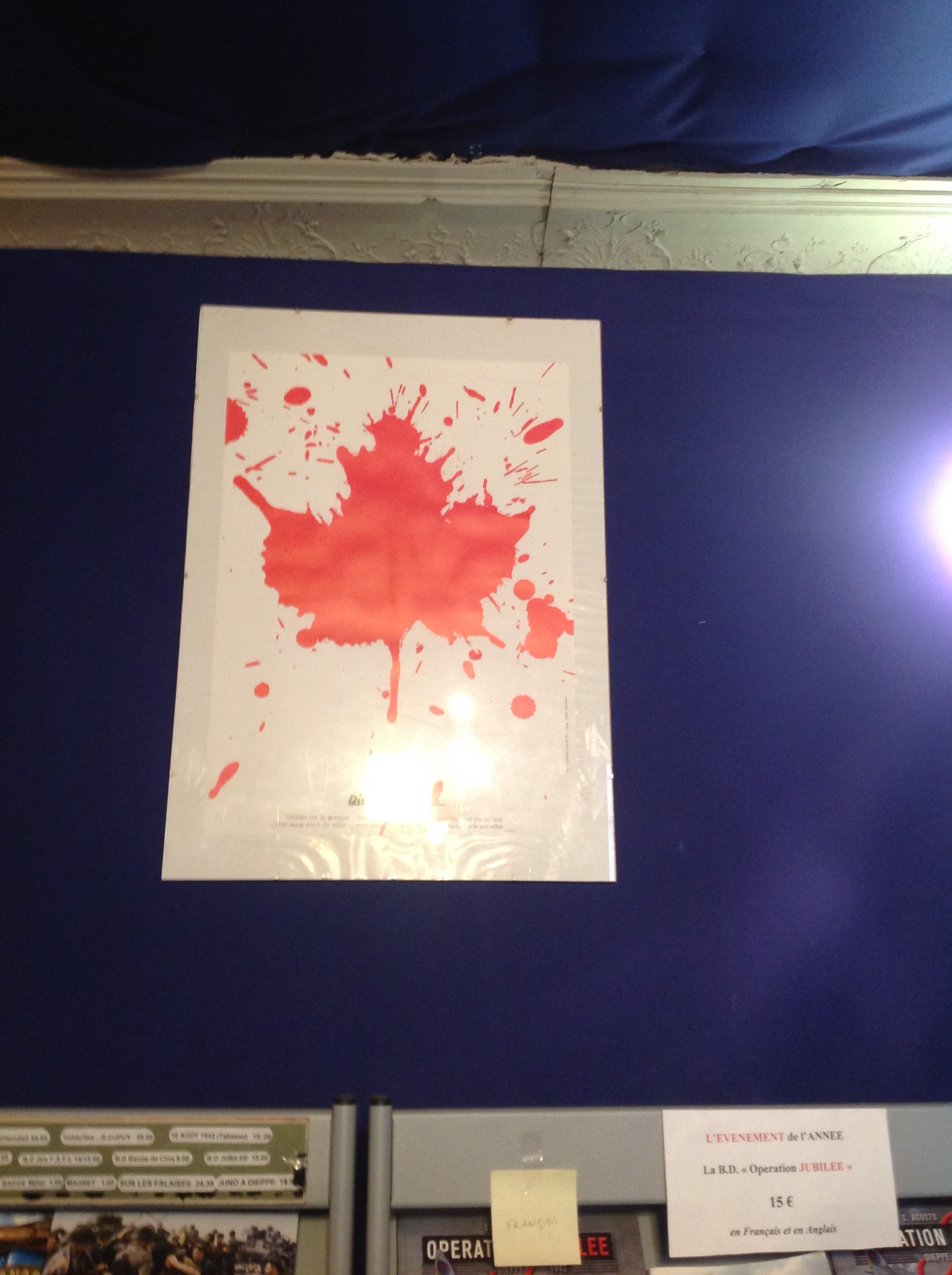 This graphic depiction of the Canadian maple leaf as a splatter of blood which hung in the entrance struck me as particularly poignant.