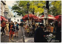 The central square is always busy with artists and tourists enjoying the sights.
