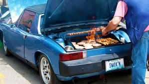 Another clever kind of tailgating - barbecuing over your gas tank in the parking lot at a football game.